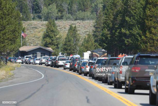 Cars line up to get into Grand Teton National Park on August 20 2017 outside Jackson Wyoming People are flocking to the Jackson and Teton National...