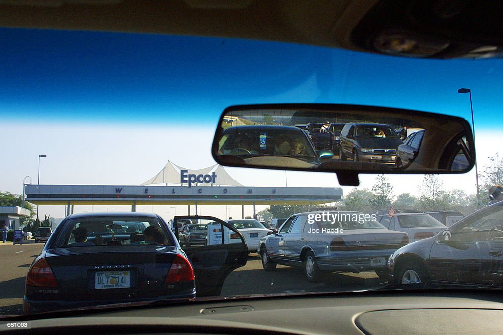 Cars line up to pay their parking toll at Walt Disney World's Epcot center November 11 2001 in Orlando Florida