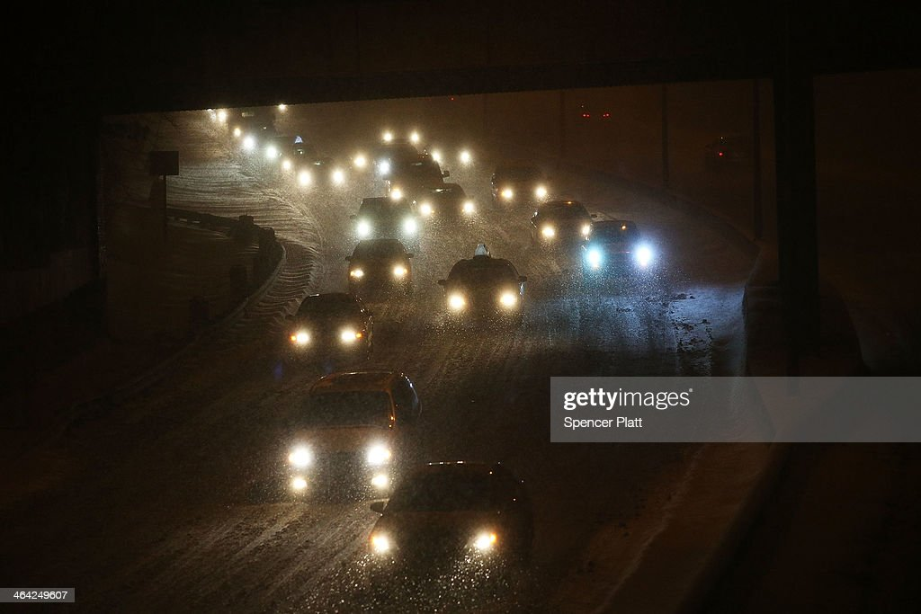 Cars make their way down a snow covered Brooklyn highway during a snow storm on January 21, 2014 in New York City. New York City is expected to receive up to 10 inches of snow, with blizzard like conditions, before the storm ends some time in the early hours of Wednesday.