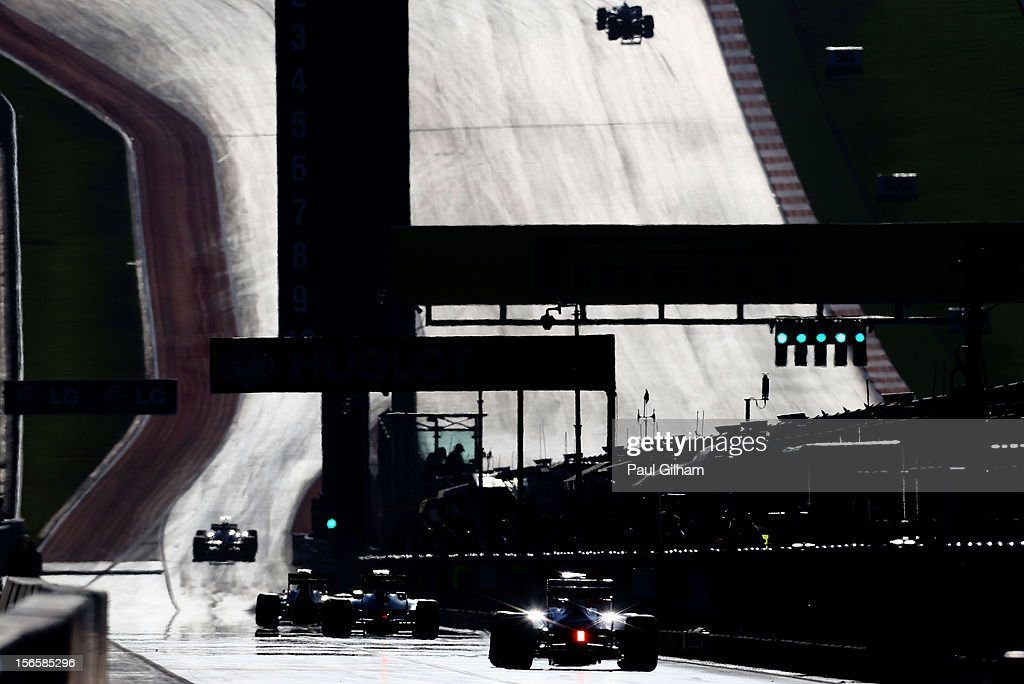 Cars make their way down the pitlane during qualifying for the United States Formula One Grand Prix at the Circuit of the Americas on November 17, 2012 in Austin, Texas.