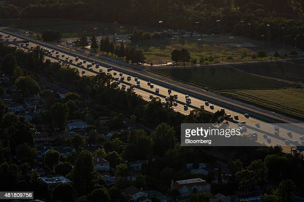 Cars move along during rush hour traffic on the US 101 Freeway in this aerial photograph taken over the Sherman Oaks neighborhood of Los Angeles...