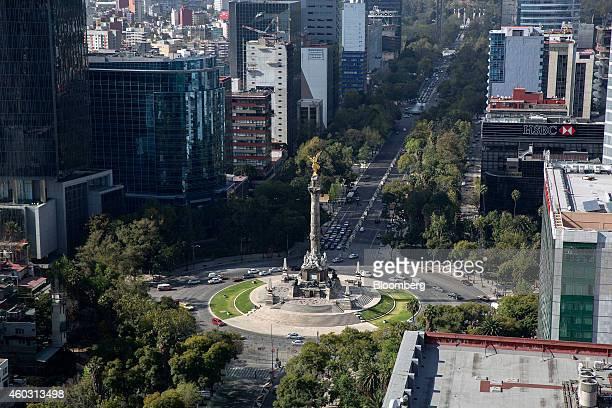 Cars move around the traffic circle surrounding the Angel of Independence monument in Mexico City Mexico on Tuesday Dec 9 2014 Stock prices for some...