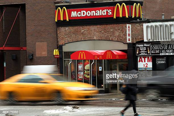 Cars move past a McDonald's in lower Manhattan on February 9 2015 in New York City McDonald's Corporation has said sales in January fell a...