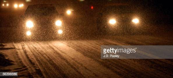 Cars negotiate a snowcovered Main Street December 8 in Bowling Green Ohio Four to six inches of snow is predicted to fall overnight marking the first...