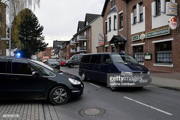 Cars of heavilyarmed members of the German SEK special forces police unit leave Schaufenberger Strasse where they made arrests on November 17 2015 in...