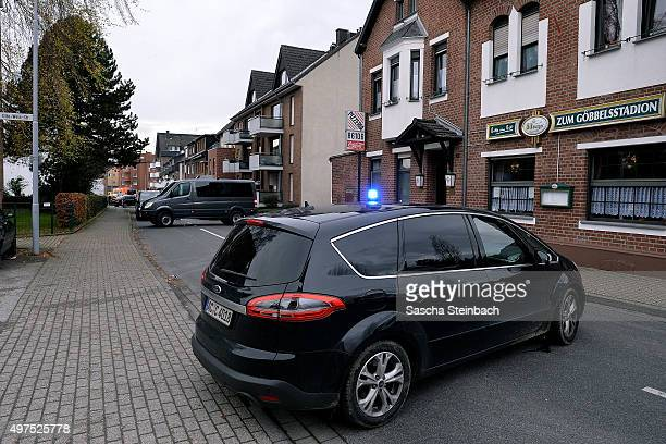 Cars of heavilyarmed members of the German SEK special forces police unit arrive at Schaufenberger Strasse where they later made arrests on November...