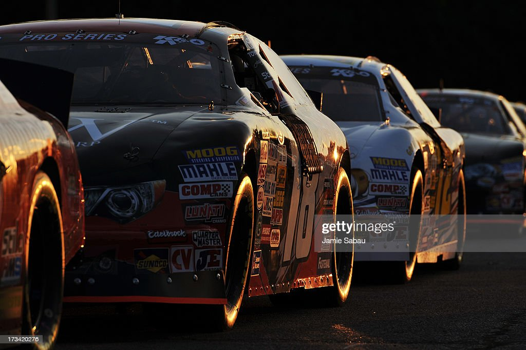 Cars of the NASCAR K&N Pro Series, East sit as the sun set before the start of the NASCAR K&N Pro Series, East NAPA 150 on July 13, 2013 at Columbus Motor Speedway in Columbus, Ohio.