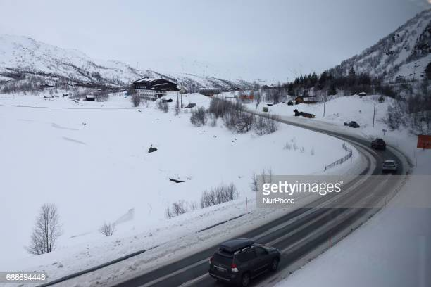 Cars on a road near a frozen lake along the OsloBergen train route on March 04 2017
