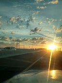 Cars On Highway At Sunset