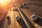 Cars on highway. Sunset cityscape. Contrejour wallpaper