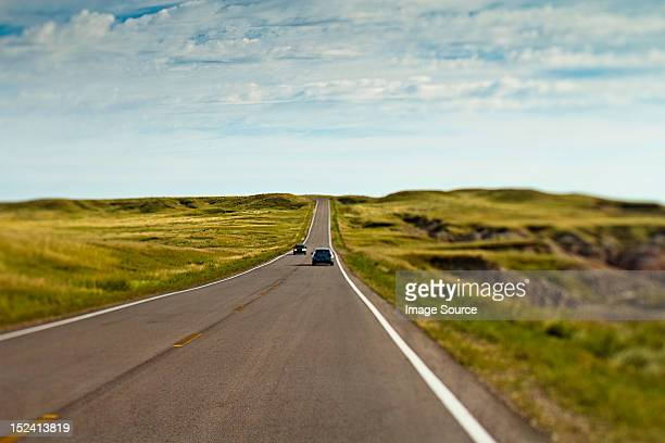 Cars on open road, Wyoming, USA
