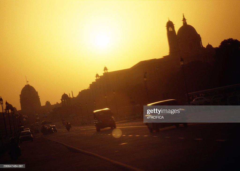Cars on road at sunset, Raj Path, India : Stock Photo