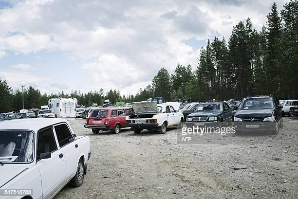 Cars on sale are showcased at a nearby trash site as asylum seekers' abandoned cars are auctioned in Salla northern Finland on July 15 2016 Over 100...