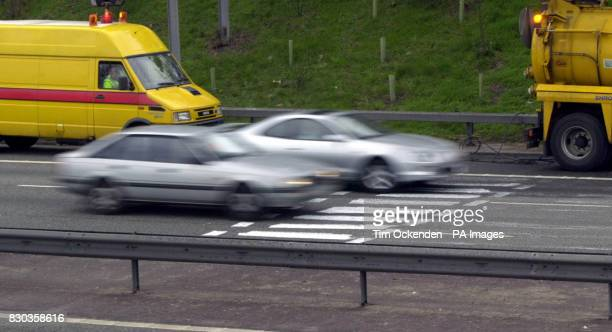 Cars on thre M3 motorway cross a zebra crossing which was painted in as an April Fool's prank Police officers discovered the bogus crossing between...