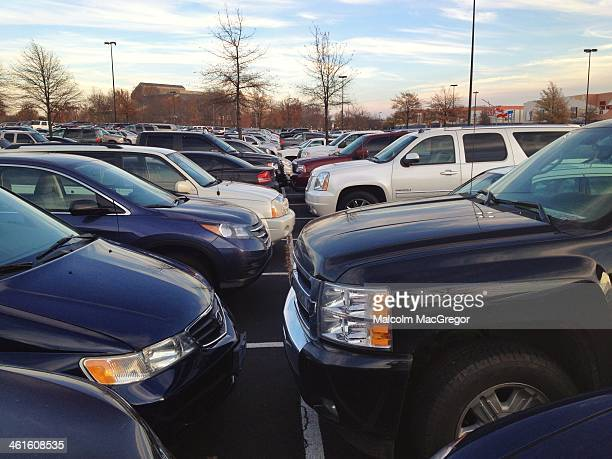 Cars pack a mall parking lot