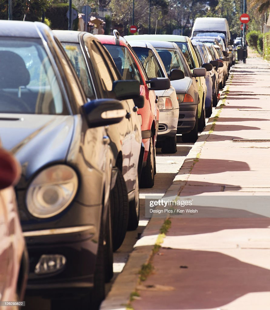 cars parked in line on street