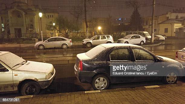 Cars Parked On Street At Night During Winter