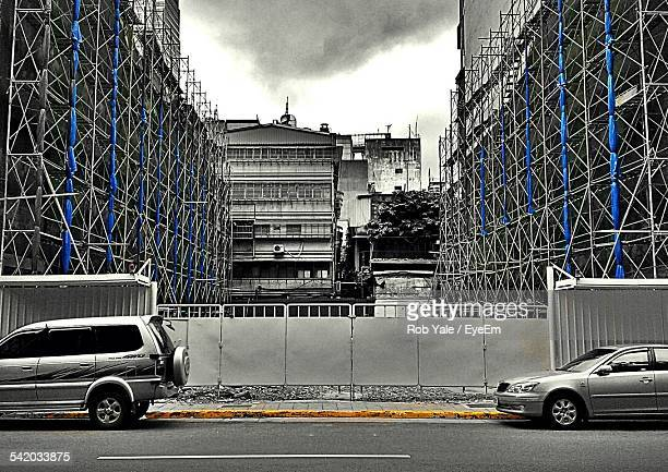 Cars Parked On Street By Buildings Under Construction