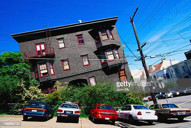 Cars parked outside a house on Filbert Street, the steepest street in San Francisco.
