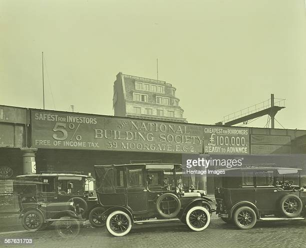 Cars parked outside London Bridge Station 1931 Cars one with whitewalled tyres parked beside the railway bridge with an advertisement for the...