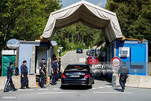Cars pass a checkpoint on a road leading to the InteralpenHotel Tirol venue of the Bilderberg conference on June 11 2015 near Telfs Austria The...