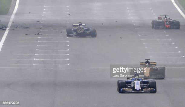 Cars pass after Antonio Giovinazzi of Italy driving the Sauber F1 Team Sauber C36 Ferrari crashed into a wall during the Formula One Grand Prix of...