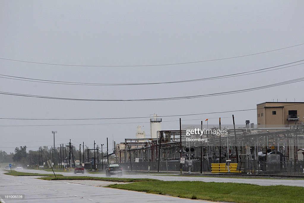 Cars pass by the Chevron Oronite Oak Point Plant that was forced to close due to Hurricane Isaac in Belle Chasse, Louisiana, U.S., on Thursday, Aug. 30, 2012. Gasoline fell on speculation that South Louisiana refineries escaped major damage from Hurricane Isaac and downtime will be limited. Photographer: Derick E. Hingle/Bloomberg via Getty Images