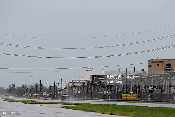 Cars pass by the Chevron Oronite Oak Point Plant that was forced to close due to Hurricane Isaac in Belle Chasse Louisiana US on Thursday Aug 30 2012...