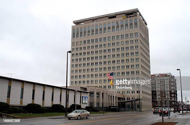 Cars pass in front of Kiewit Plaza the location of Berkshire Hathaway Inc headquarters in Omaha Nebraska US on Thursday April 11 2013 Warren...