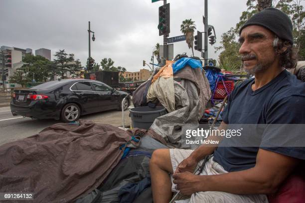 Cars pass the encampment of a man whose been homeless for about two years on May 1 2017 in Los Angeles California The newly released 2017 Greater Los...