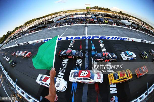 Cars pass the green flag to start the NASCAR KN Pro Series East United Site Services 70 at New Hampshire Motor Speedway on July 15 2017 in Loudon New...