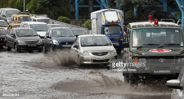 Cars pass through logged water on Western Express Highway at Bandra after heavy rain