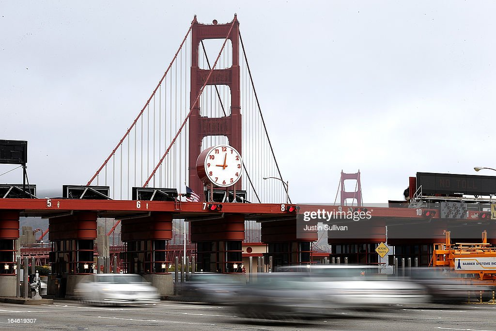 Cars pass through the Golden Gate Bridge toll plaza during the morning commute on March 25, 2013 in San Francisco, California. Workers are making last minute changes to the Golden Gate Bridge toll plaza in preparation of making the iconic bridge the first major toll bridge in the nation to go to all electronic tollbooths. The entire staff of full time toll collectors will be replaced by the automated booths starting on March 27.