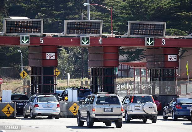 Cars pass through the Golden Gate Bridge toll plaza on September 19 2012 in San Francisco California Golden Gate Bridge officials announced on...