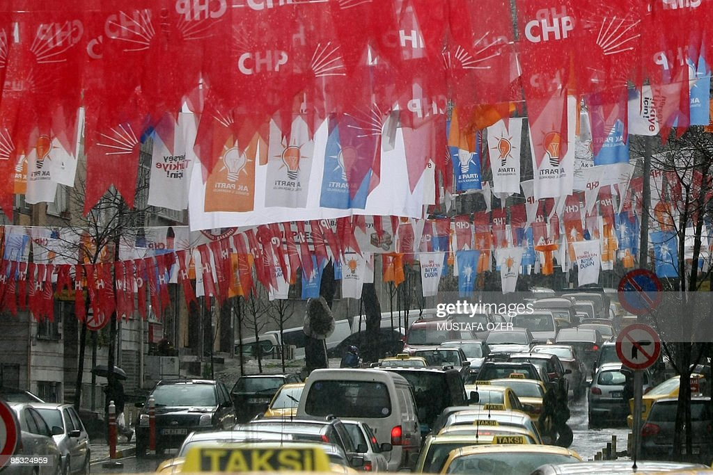 Cars pass under electoral flags in a street of Istanbul, on March 10, 2009. Police arrested five people yesterday in the southern Turkish city of Adana on suspicion that they were planning an attack against Prime Minister Recep Tayyip Erdogan, media reports said. Erdogan, who heads the ruling Islamist-rooted Justice and Development Party, was in Adana as part of his election campaign ahead of municipal polls on March 29.
