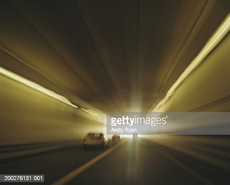 Cars passing tunnel (blurred motion) : Stock Photo