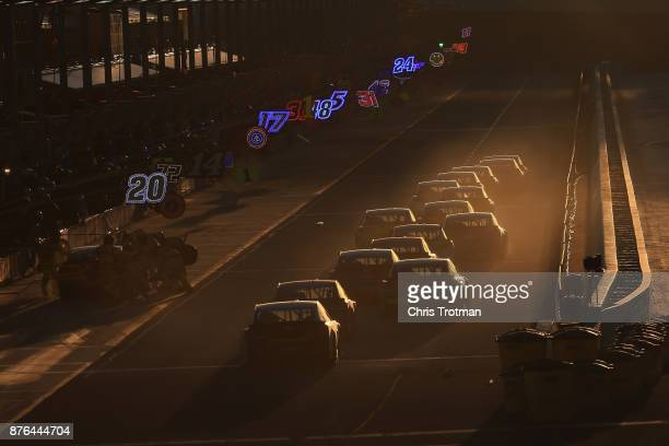 Cars pit during the Monster Energy NASCAR Cup Series Championship Ford EcoBoost 400 at HomesteadMiami Speedway on November 19 2017 in Homestead...