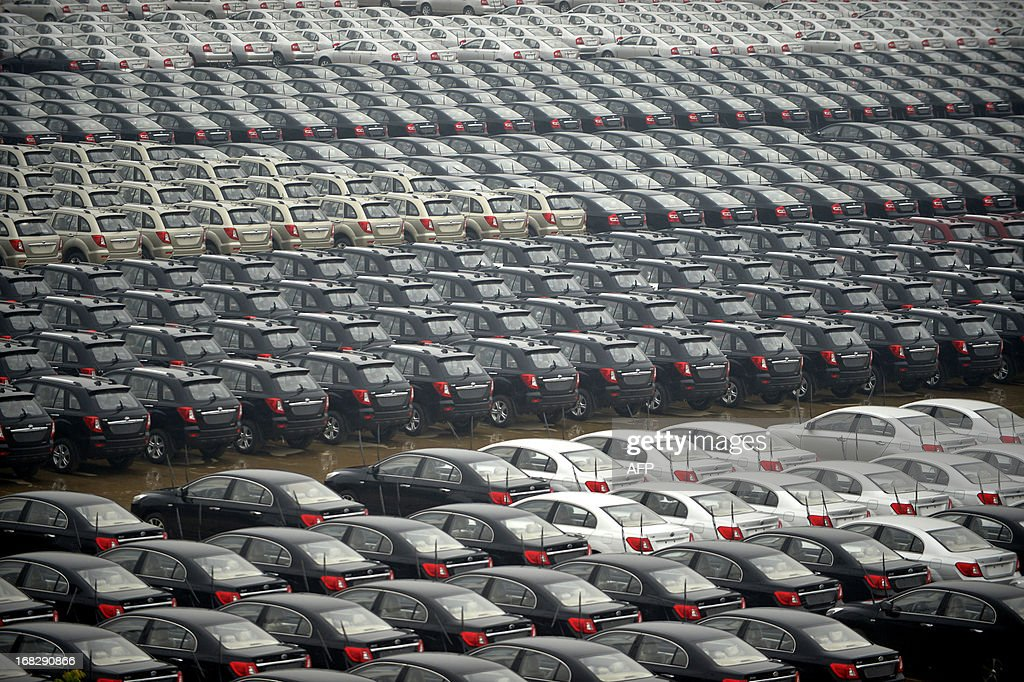 Cars produced by a Chinese private vehicle company are park on a parking lot close to a port on the Yangtze River in Wuhan, central China's Hubei province on May 8, 2013. China swung back to trade surplus in April after posting a rare deficit the previous month, official data showed on May 8, but analysts cautioned the better-than-expected figures may not reflect reality. CHINA OUT AFP PHOTO