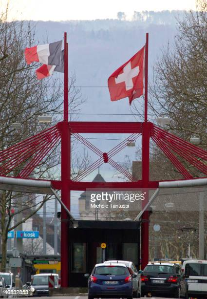 Cars queue at the border crossing between France and Switzerland on February 10 2014 at St Louis France Swiss citizens voted with a narrow majority...