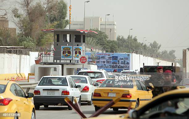 Cars queue to cross into Baghdad's 'Green Zone' on October 5 2015 after the area was opened the previous day to the public for the first time in 12...