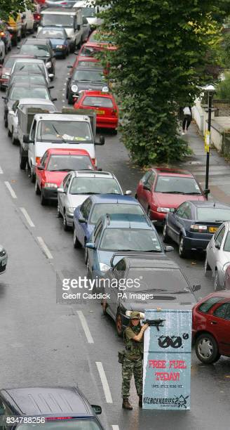 Cars queue up to receive free petrol during an Electronic Arts promotion for a new computer game which gave 20000worth of fuel away free of charge at...