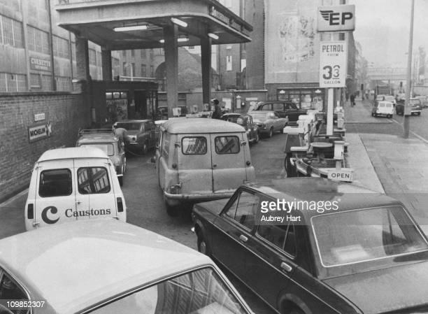 Cars queuing at a petrol station in Southwark London during a petrol shortage November 1973