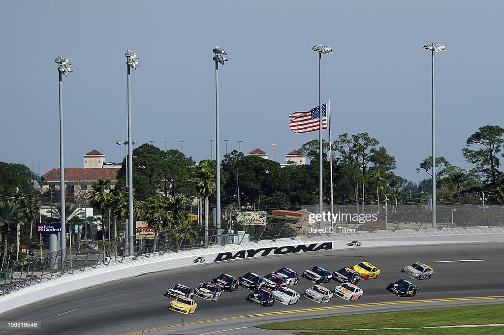 Cars race during NASCAR Sprint Cup Series Preseason Thunder testing at Daytona International Speedway on January 11, 2013 in Daytona Beach, Florida.