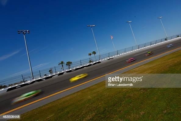 Cars race during qualifying for the 57th Annual Daytona 500 at Daytona International Speedway on February 15 2015 in Daytona Beach Florida