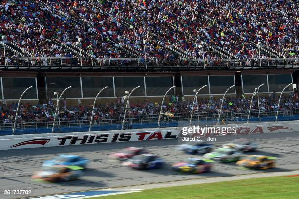 Cars race during the Monster Energy NASCAR Cup Series Alabama 500 at Talladega Superspeedway on October 15 2017 in Talladega Alabama