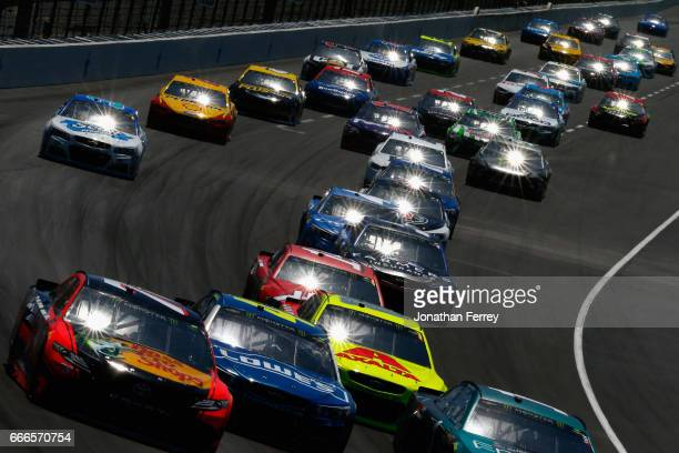 Cars race during the Monster Energy NASCAR Cup Series O'Reilly Auto Parts 500 at Texas Motor Speedway on April 9 2017 in Fort Worth Texas