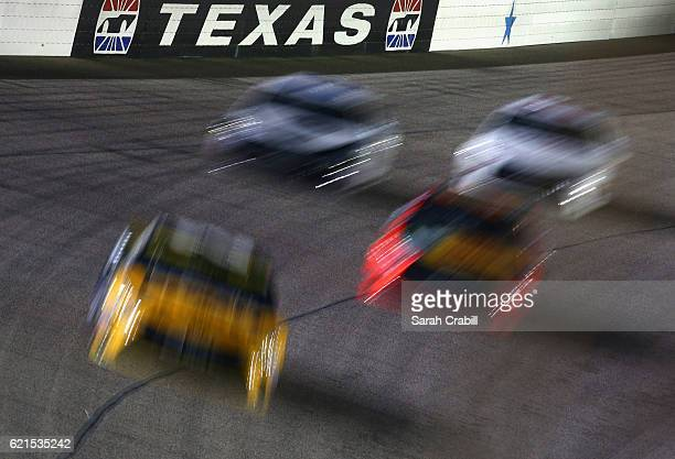 Cars race during the NASCAR Sprint Cup Series AAA Texas 500 at Texas Motor Speedway on November 6 2016 in Fort Worth Texas
