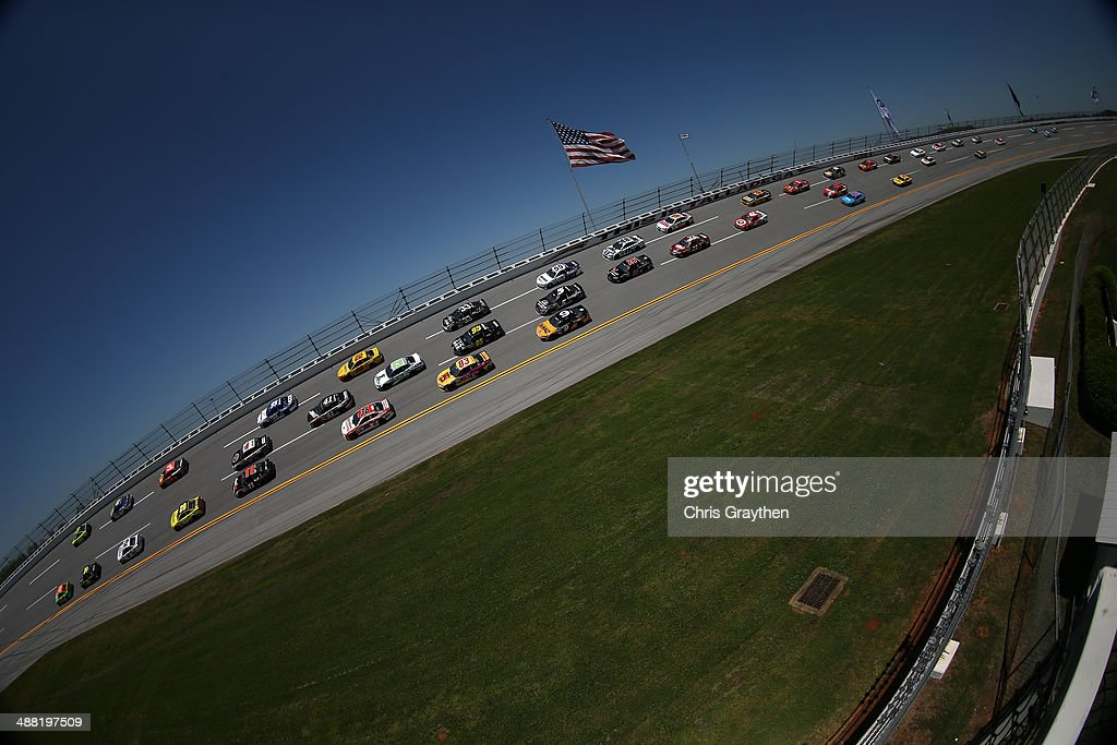 Cars race during the NASCAR Sprint Cup Series Aaron's 499 at Talladega Superspeedway on May 4, 2014 in Talladega, Alabama.