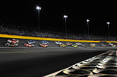 Cars race during the NASCAR Sprint Cup Series CocaCola 600 at Charlotte Motor Speedway on May 24 2015 in Charlotte North Carolina
