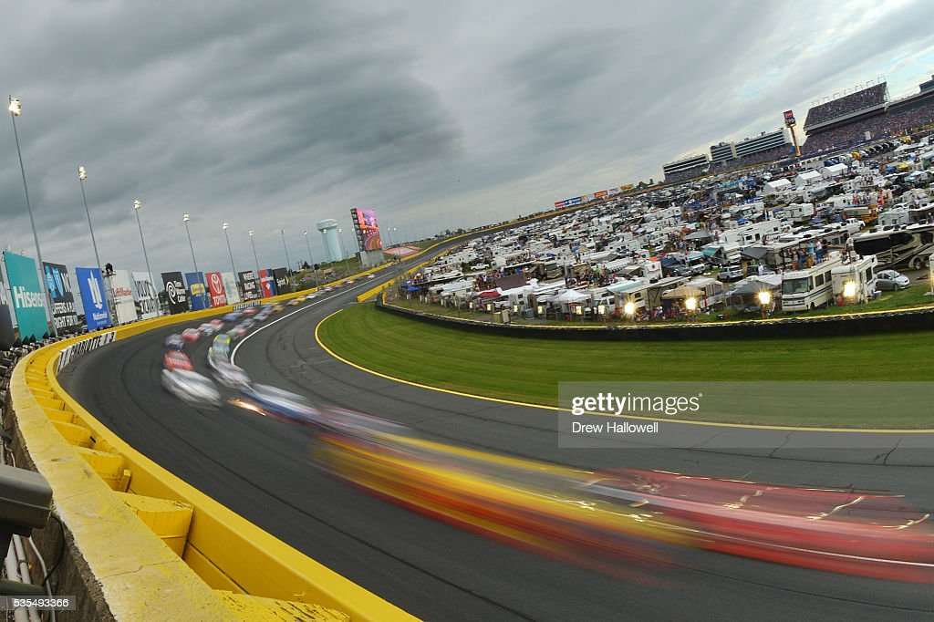 Cars race during the NASCAR Sprint Cup Series Coca-Cola 600 at Charlotte Motor Speedway on May 29, 2016 in Charlotte, North Carolina.